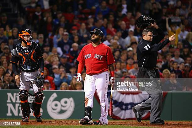 Pablo Sandoval of the Boston Red Sox reacts after being struck in the back by a pitch from Ubaldo Jimenez of the Baltimore Orioles during the fourth...