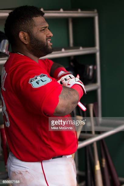 Pablo Sandoval of the Boston Red Sox takes off his Franklin batting gloves during the spring Training game against the Team USA at Jet Blu Park on...