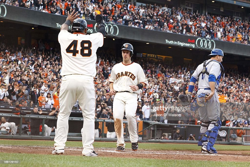 <a gi-track='captionPersonalityLinkClicked' href=/galleries/search?phrase=Pablo+Sandoval&family=editorial&specificpeople=803207 ng-click='$event.stopPropagation()'>Pablo Sandoval</a> #48 of the San Francisco Giants and <a gi-track='captionPersonalityLinkClicked' href=/galleries/search?phrase=Buster+Posey&family=editorial&specificpeople=4896435 ng-click='$event.stopPropagation()'>Buster Posey</a> #28 score runs off a double from Hunter Pence #8 (not pictured) during the fifth inning against the Los Angeles Dodgers at AT&T Park on May 5, 2013 in San Francisco, California.