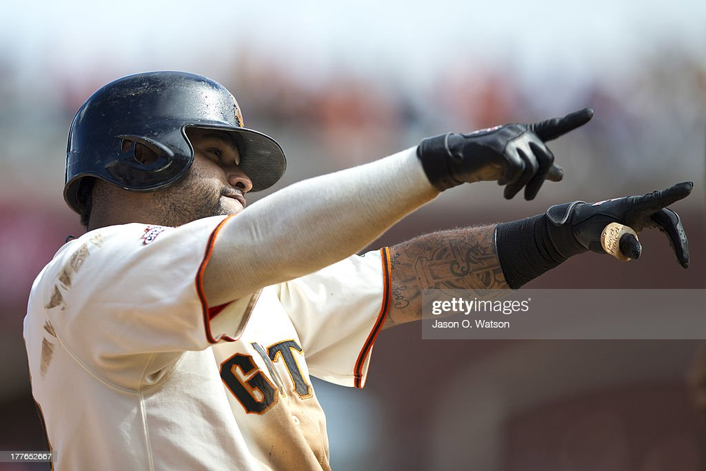 <a gi-track='captionPersonalityLinkClicked' href=/galleries/search?phrase=Pablo+Sandoval&family=editorial&specificpeople=803207 ng-click='$event.stopPropagation()'>Pablo Sandoval</a> #48 of the San Francisco Giants celebrates after hitting a two RBI triple against the Pittsburgh Pirates during the eighth inning at AT&T Park on August 25, 2013 in San Francisco, California.