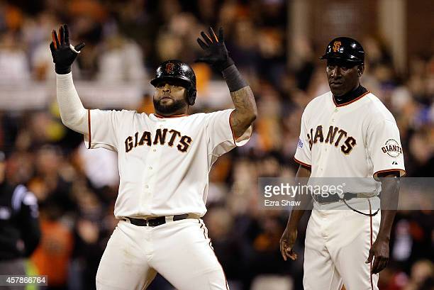 Pablo Sandoval of the San Francisco Giants celebrates after hitting a tworun single in the sixth inning against the Kansas City Royals during Game...