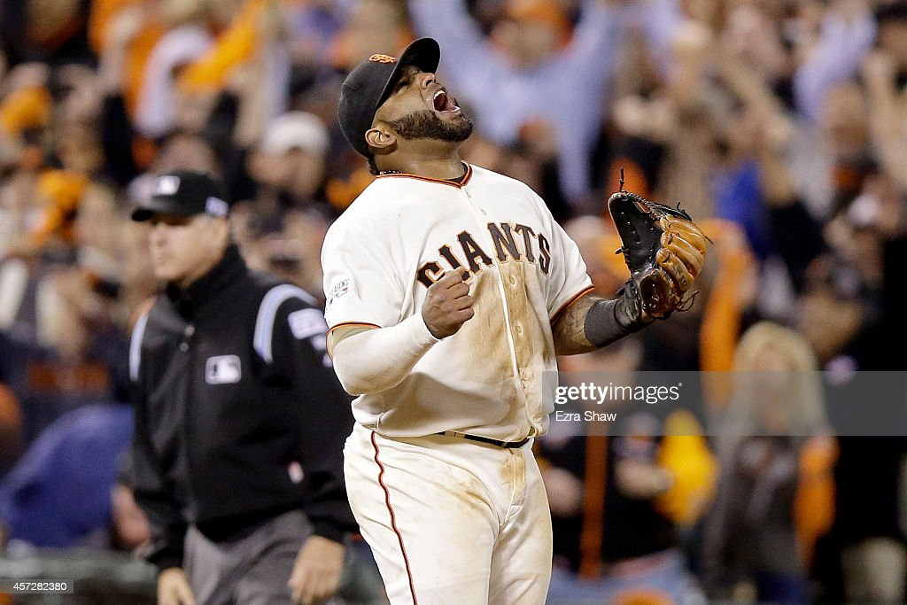 Pablo Sandoval #48 of the San Francisco Giants celebrates after the Giants defeat the St. Louis Cardinals 6-4 in Game Four of the National League Championship Series at AT&T Park on October 15, 2014 in San Francisco, California.