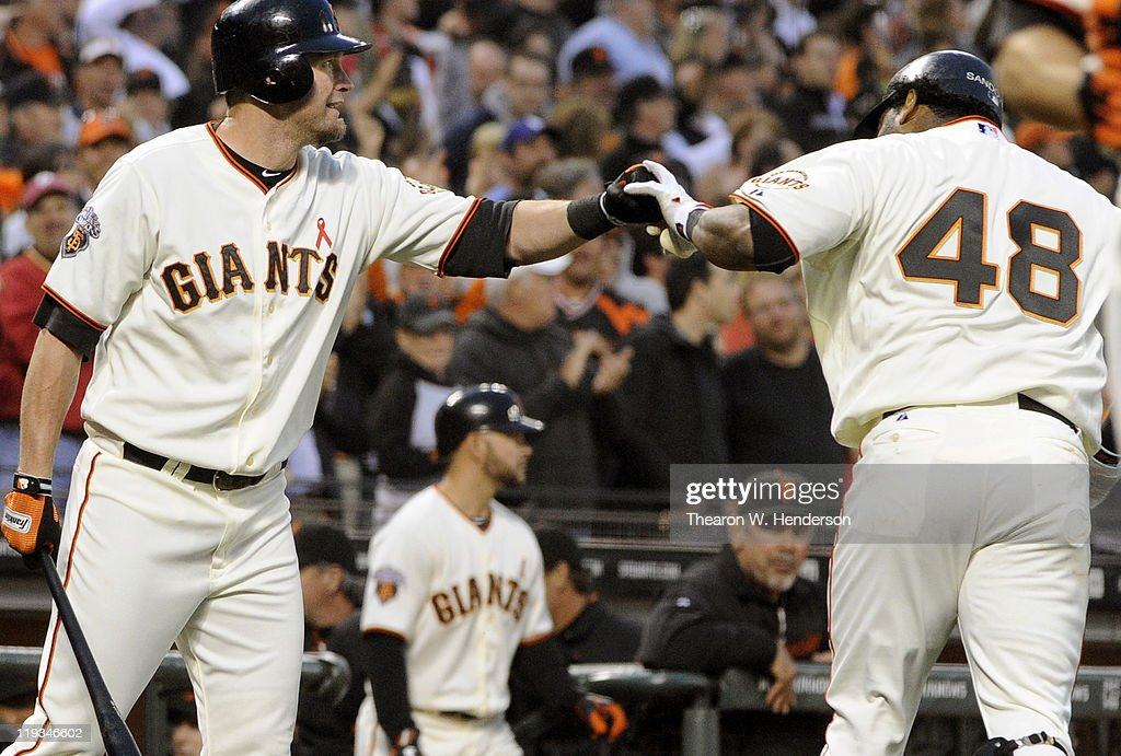 <a gi-track='captionPersonalityLinkClicked' href=/galleries/search?phrase=Pablo+Sandoval&family=editorial&specificpeople=803207 ng-click='$event.stopPropagation()'>Pablo Sandoval</a> #48 of the San Francisco Giants celebrates with teammate <a gi-track='captionPersonalityLinkClicked' href=/galleries/search?phrase=Aubrey+Huff&family=editorial&specificpeople=208964 ng-click='$event.stopPropagation()'>Aubrey Huff</a> after Sandoval hit a home run off of Chad Billingsley #58 of the Los Angeles Dodgers in the fourth inning during an MLB baseball game at AT&T Park July 18, 2011 in San Francisco, California.