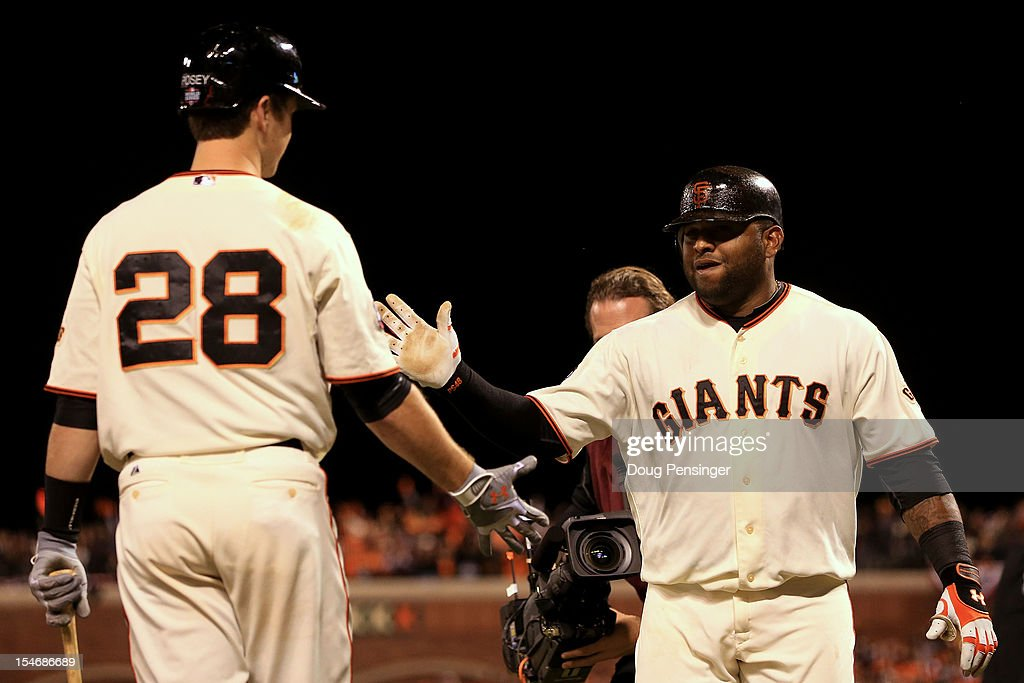 <a gi-track='captionPersonalityLinkClicked' href=/galleries/search?phrase=Pablo+Sandoval&family=editorial&specificpeople=803207 ng-click='$event.stopPropagation()'>Pablo Sandoval</a> #48 of the San Francisco Giants celebrates with teammate <a gi-track='captionPersonalityLinkClicked' href=/galleries/search?phrase=Buster+Posey&family=editorial&specificpeople=4896435 ng-click='$event.stopPropagation()'>Buster Posey</a> #28 after hitting a solo home run to center field against Al Alburquerque #62 of the Detroit Tigers in the fifth inning during Game One of the Major League Baseball World Series at AT&T Park on October 24, 2012 in San Francisco, California.