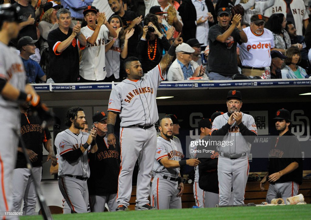 <a gi-track='captionPersonalityLinkClicked' href=/galleries/search?phrase=Pablo+Sandoval&family=editorial&specificpeople=803207 ng-click='$event.stopPropagation()'>Pablo Sandoval</a> #48 of the San Francisco Giants, center, point out to second base after Gregor Blanco #7 hit an RBI double during the eighth inning of a baseball game against the San Diego Padres at Petco Park on July 11, 2013 in San Diego, California.