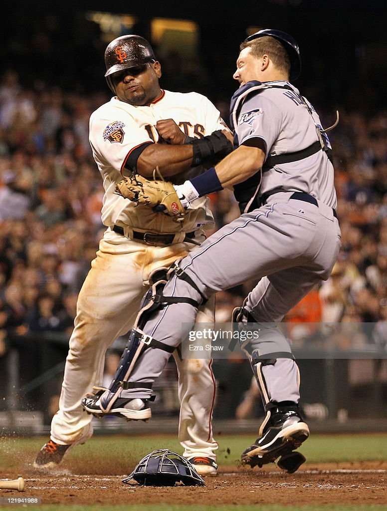 <a gi-track='captionPersonalityLinkClicked' href=/galleries/search?phrase=Pablo+Sandoval&family=editorial&specificpeople=803207 ng-click='$event.stopPropagation()'>Pablo Sandoval</a> #48 of the San Francisco Giants collides with catcher <a gi-track='captionPersonalityLinkClicked' href=/galleries/search?phrase=Nick+Hundley&family=editorial&specificpeople=4175399 ng-click='$event.stopPropagation()'>Nick Hundley</a> #4 of the San Diego Padres in fifth inning at AT&T Park on August 23, 2011 in San Francisco, California. Hundley dropped the ball on the play and Sandoval was safe at home plate.