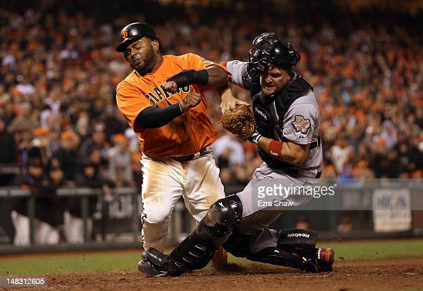 Pablo Sandoval of the San Francisco Giants collides with Chris Snyder of the Houston Astros in the eighth inning at ATT Park on July 13 2012 in San...