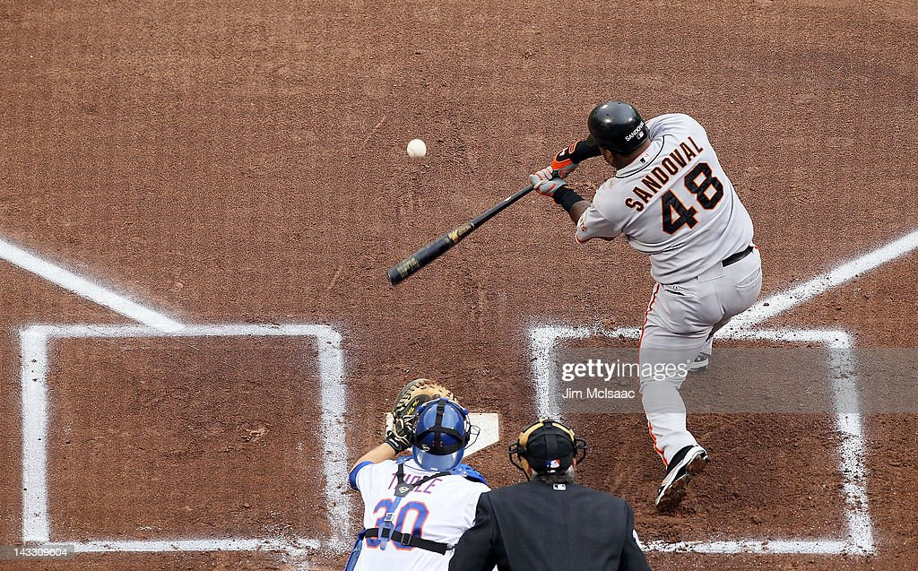 <a gi-track='captionPersonalityLinkClicked' href=/galleries/search?phrase=Pablo+Sandoval&family=editorial&specificpeople=803207 ng-click='$event.stopPropagation()'>Pablo Sandoval</a> #48 of the San Francisco Giants connects on a first inning RBI single against the New York Mets at Citi Field on April 23, 2012 in the Flushing neighborhood of the Queens borough of New York City.