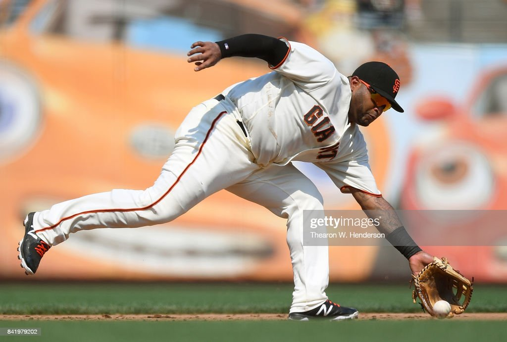 Pablo Sandoval #48 of the San Francisco Giants goes down to field a ground ball off the bat of Jose Martinez #58 of the St. Louis Cardinals in the top of the six inning at AT&T Park on September 2, 2017 in San Francisco, California.