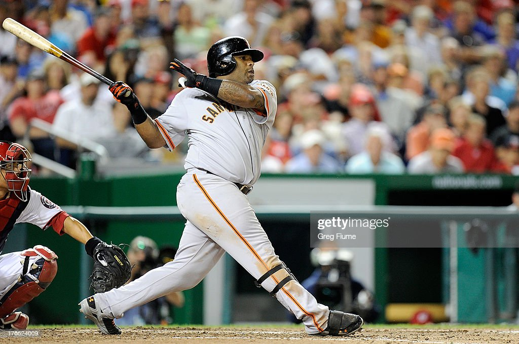 <a gi-track='captionPersonalityLinkClicked' href=/galleries/search?phrase=Pablo+Sandoval&family=editorial&specificpeople=803207 ng-click='$event.stopPropagation()'>Pablo Sandoval</a> #48 of the San Francisco Giants hits a double in the eighth inning against the Washington Nationals at Nationals Park on August 14, 2013 in Washington, DC.
