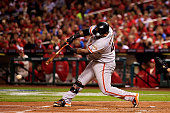Pablo Sandoval of the San Francisco Giants hits a double in the second inning against the St Louis Cardinals during Game One of the National League...