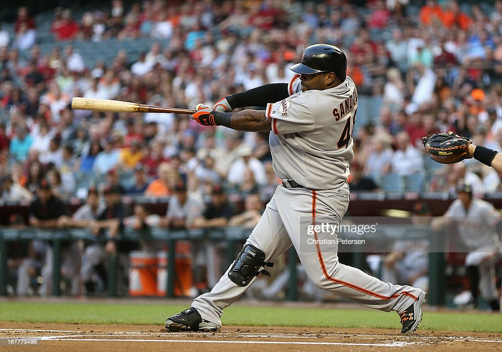 <a gi-track='captionPersonalityLinkClicked' href=/galleries/search?phrase=Pablo+Sandoval&family=editorial&specificpeople=803207 ng-click='$event.stopPropagation()'>Pablo Sandoval</a> #48 of the San Francisco Giants hits a single against the Arizona Diamondbacks during the first inning of the MLB game at Chase Field on April 29, 2013 in Phoenix, Arizona.