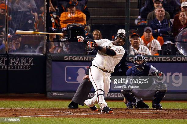 Pablo Sandoval of the San Francisco Giants hits a solo home run to center field against Al Alburquerque of the Detroit Tigers in the fifth inning...