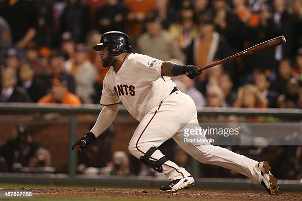 Pablo Sandoval of the San Francisco Giants hits a two RBI single in the bottom of the sixth inning of Game 4 of the 2014 World Series against the...