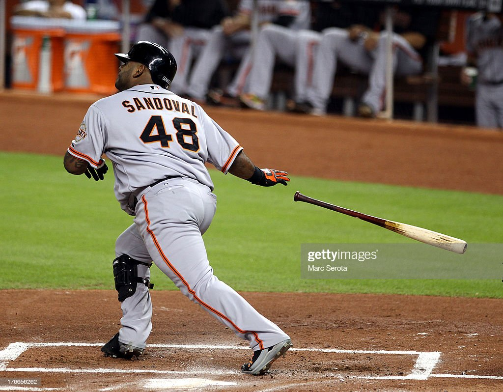 <a gi-track='captionPersonalityLinkClicked' href=/galleries/search?phrase=Pablo+Sandoval&family=editorial&specificpeople=803207 ng-click='$event.stopPropagation()'>Pablo Sandoval</a> #48 of the San Francisco Giants hits a two run double against the Miami Marlins during the first inning at Marlins Park on August 16, 2013 in Miami, Florida.