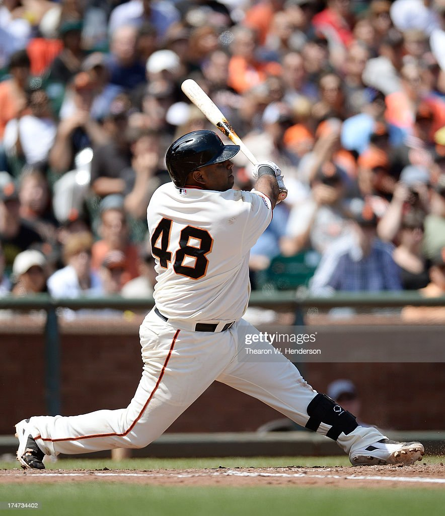 Pablo Sandoval #48 of the San Francisco Giants hits an RBI double scoring Marco Scutaro #19 in the fifth inning against the Chicago Cubs at AT&T Park on July 28, 2013 in San Francisco, California.