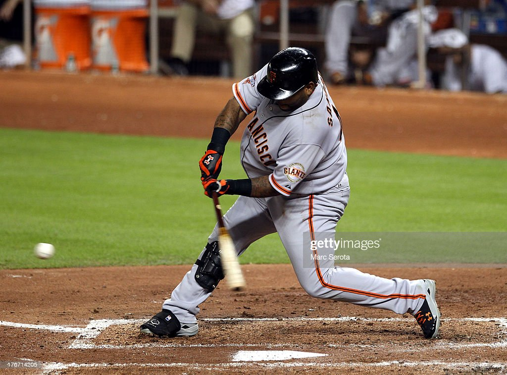 <a gi-track='captionPersonalityLinkClicked' href=/galleries/search?phrase=Pablo+Sandoval&family=editorial&specificpeople=803207 ng-click='$event.stopPropagation()'>Pablo Sandoval</a> #48 of the San Francisco Giants hits an RBI single against the Miami Marlins during the fourth inning at Marlins Park on August 17, 2013 in Miami, Florida.