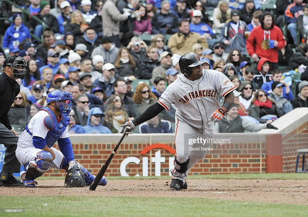 <a gi-track='captionPersonalityLinkClicked' href=/galleries/search?phrase=Pablo+Sandoval&family=editorial&specificpeople=803207 ng-click='$event.stopPropagation()'>Pablo Sandoval</a> #48 of the San Francisco Giants hits an RBI single during the sixth inning against the Chicago Cubs on April 13, 2013 at Wrigley Field in Chicago, Illinois.