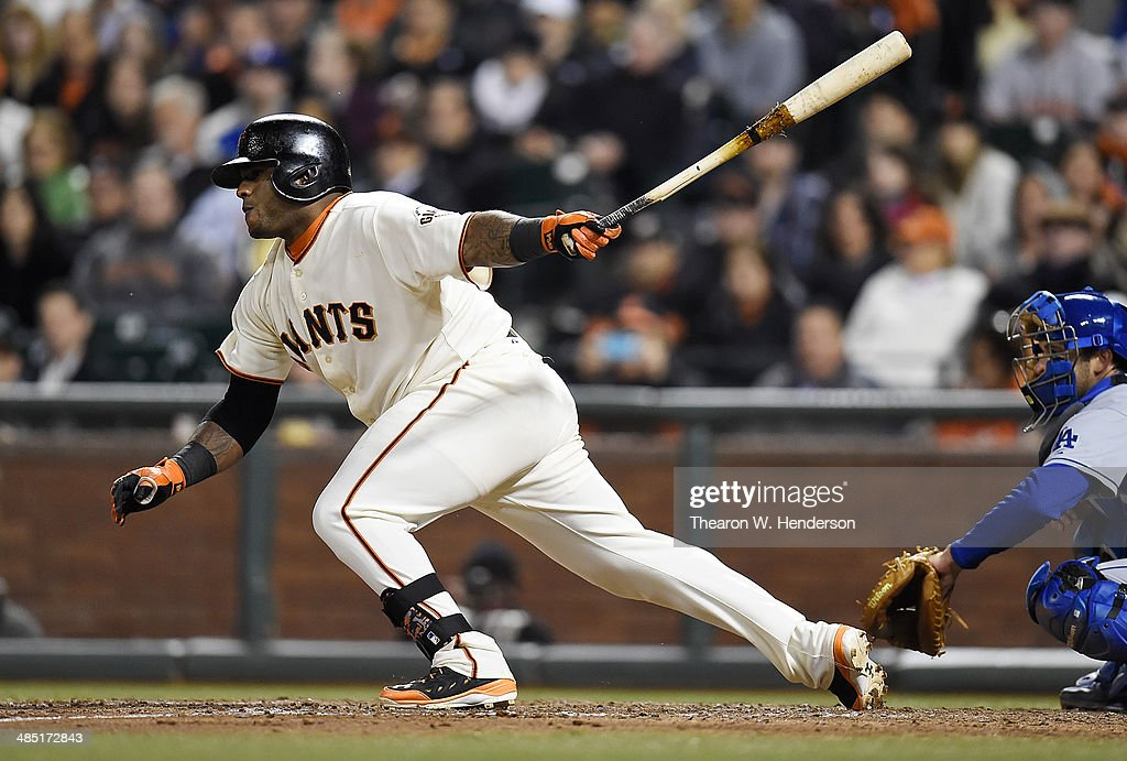 <a gi-track='captionPersonalityLinkClicked' href=/galleries/search?phrase=Pablo+Sandoval&family=editorial&specificpeople=803207 ng-click='$event.stopPropagation()'>Pablo Sandoval</a> #48 of the San Francisco Giants hits an RBI single scoring Joaquin Arias #13 (not pictured) in the bottom of the seventh inning against the Los Angeles Dodgers at AT&T Park on April 16, 2014 in San Francisco, California.