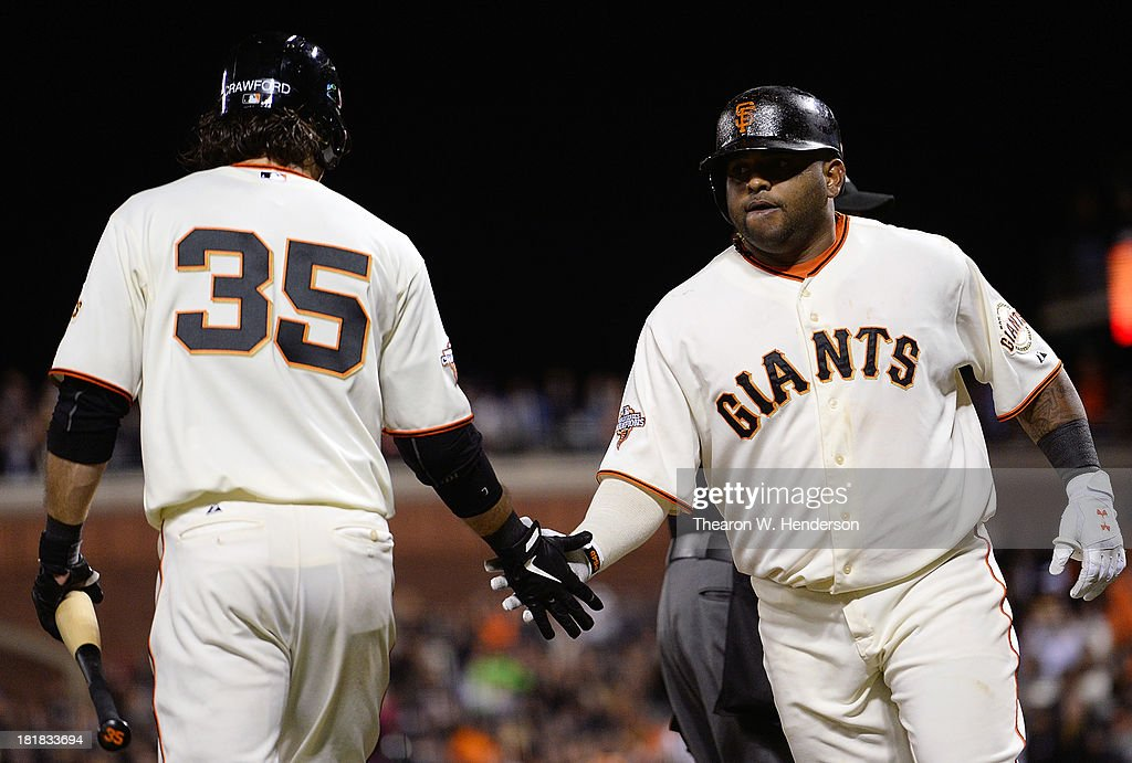 <a gi-track='captionPersonalityLinkClicked' href=/galleries/search?phrase=Pablo+Sandoval&family=editorial&specificpeople=803207 ng-click='$event.stopPropagation()'>Pablo Sandoval</a> #48 of the San Francisco Giants is congratulated by <a gi-track='captionPersonalityLinkClicked' href=/galleries/search?phrase=Brandon+Crawford&family=editorial&specificpeople=5580312 ng-click='$event.stopPropagation()'>Brandon Crawford</a> #35 after Sandoval hit a two-run homer during the fourth inning against the Los Angeles Dodgers at AT&T Park on September 25, 2013 in San Francisco, California.