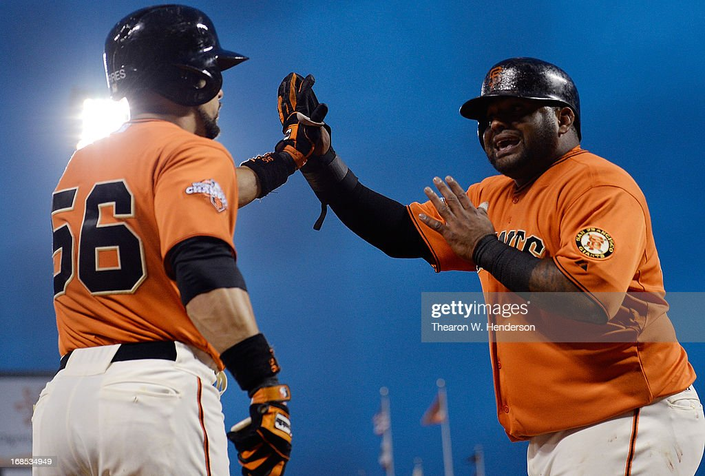 <a gi-track='captionPersonalityLinkClicked' href=/galleries/search?phrase=Pablo+Sandoval&family=editorial&specificpeople=803207 ng-click='$event.stopPropagation()'>Pablo Sandoval</a> #48 of the San Francisco Giants is congratulated by <a gi-track='captionPersonalityLinkClicked' href=/galleries/search?phrase=Andres+Torres&family=editorial&specificpeople=835839 ng-click='$event.stopPropagation()'>Andres Torres</a> #56 after Sandoval scored against the Atlanta Braves in the fourth inning at AT&T Park on May 10, 2013 in San Francisco, California. Sandoval scored on an infield single by Hunter Pence.