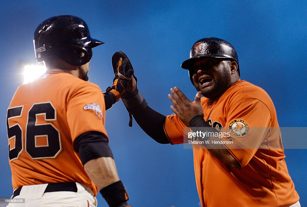 Pablo Sandoval #48 of the San Francisco Giants is congratulated by Andres Torres #56 after Sandoval scored against the Atlanta Braves in the fourth inning at AT&T Park on May 10, 2013 in San Francisco, California. Sandoval scored on an infield single by Hunter Pence.