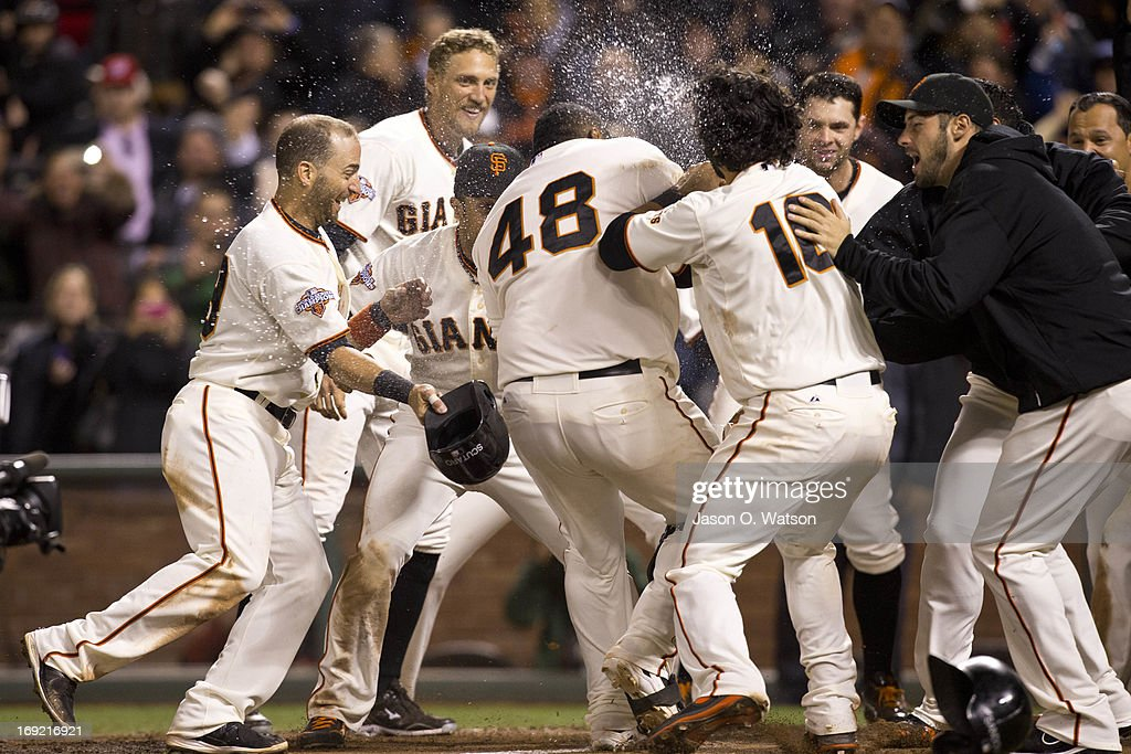 Pablo Sandoval #48 of the San Francisco Giants is congratulated by teammates at home plate after hitting a two run walk-off home run against the Washington Nationals during the tenth inning at AT&T Park on May 21, 2013 in San Francisco, California. The San Francisco Giants defeated the Washington Nationals 4-2 in 10 innings.