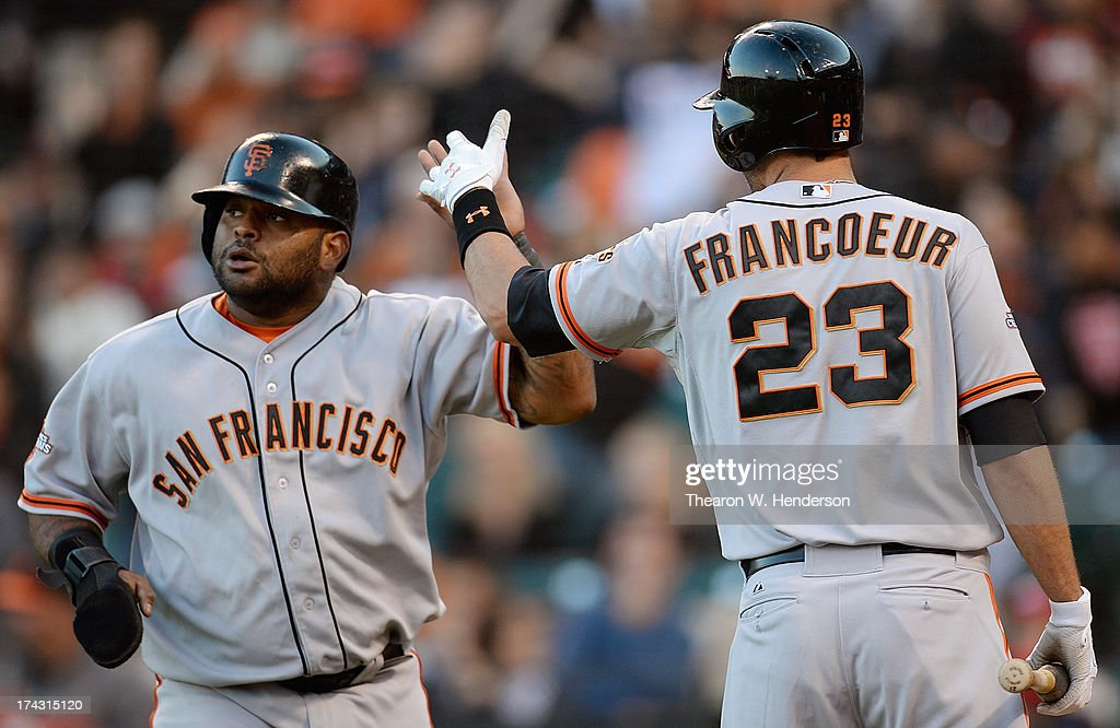 <a gi-track='captionPersonalityLinkClicked' href=/galleries/search?phrase=Pablo+Sandoval&family=editorial&specificpeople=803207 ng-click='$event.stopPropagation()'>Pablo Sandoval</a> #48 of the San Francisco Giants is congratulated by <a gi-track='captionPersonalityLinkClicked' href=/galleries/search?phrase=Jeff+Francoeur&family=editorial&specificpeople=217574 ng-click='$event.stopPropagation()'>Jeff Francoeur</a> #23 after Sandoval scored on an RBI single from Hunter Pence #8 in the first inning against the Cincinnati Reds at AT&T Park on July 23, 2013 in San Francisco, California.