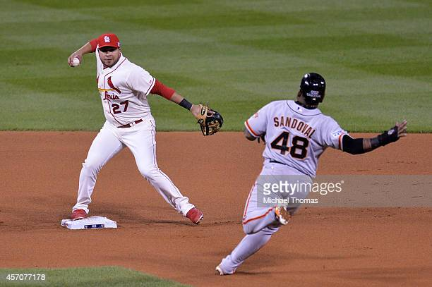 Pablo Sandoval of the San Francisco Giants is forced out at second base by Jhonny Peralta of the St Louis Cardinals in the third inning during Game...