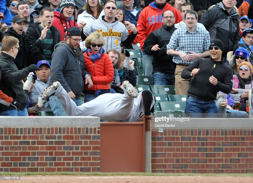 <a gi-track='captionPersonalityLinkClicked' href=/galleries/search?phrase=Pablo+Sandoval&family=editorial&specificpeople=803207 ng-click='$event.stopPropagation()'>Pablo Sandoval</a> #48 of the San Francisco Giants makes a catch in the stands against the Chicago Cubs during the ninth inning on April 13, 2013 at Wrigley Field in Chicago, Illinois. The San Francisco Giants defeated the Chicago Cubs 3-2.