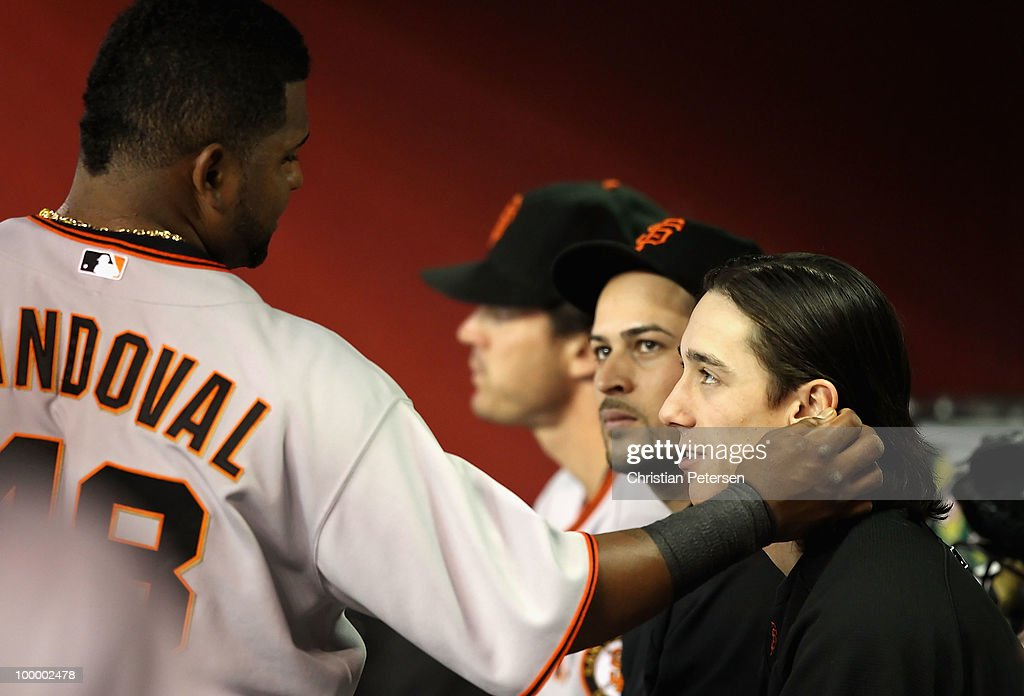 Pablo Sandoval #48 of the San Francisco Giants plays with the hair of pitcher Tim Lincecum #55 in the dugout during the Major League Baseball game against the Arizona Diamondbacks at Chase Field on May 19, 2010 in Phoenix, Arizona.