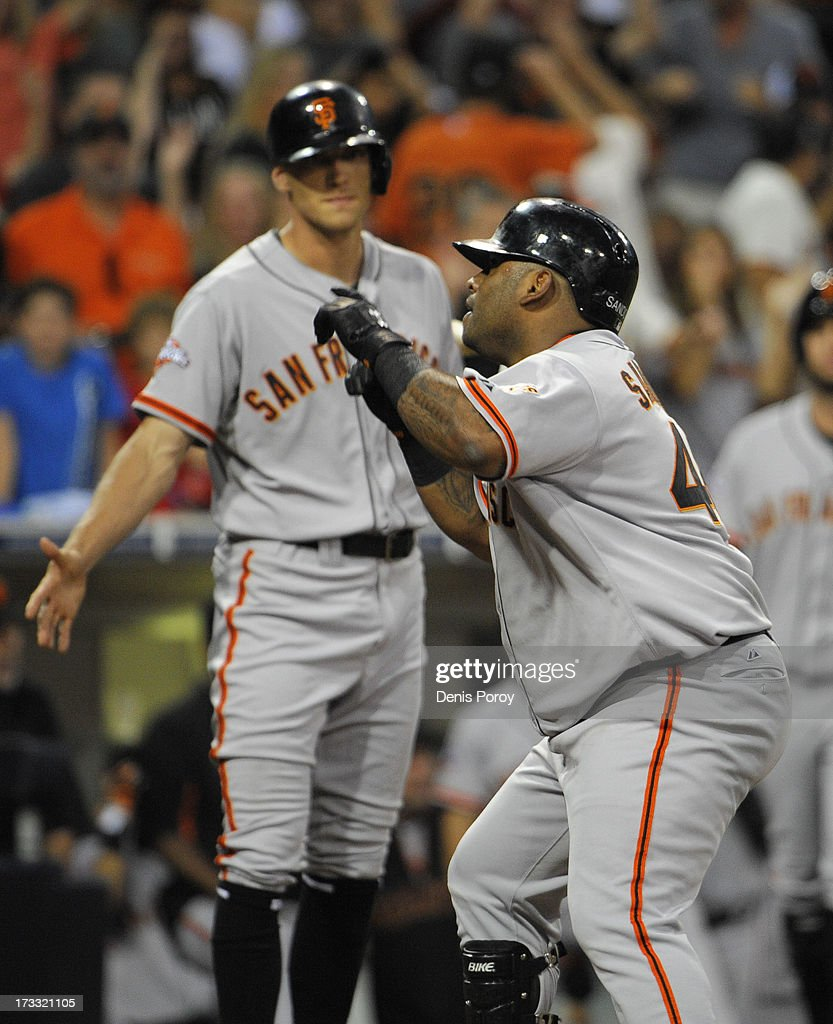 <a gi-track='captionPersonalityLinkClicked' href=/galleries/search?phrase=Pablo+Sandoval&family=editorial&specificpeople=803207 ng-click='$event.stopPropagation()'>Pablo Sandoval</a> #48 of the San Francisco Giants points skyward as <a gi-track='captionPersonalityLinkClicked' href=/galleries/search?phrase=Hunter+Pence&family=editorial&specificpeople=757341 ng-click='$event.stopPropagation()'>Hunter Pence</a> #8 looks on after Sandoval hit a solo home run during the fourth inning of a baseball game against the San Diego Padres at Petco Park on July 11, 2013 in San Diego, California.