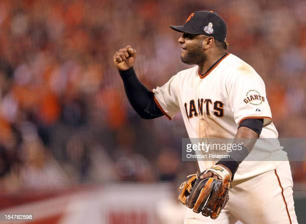 Pablo Sandoval of the San Francisco Giants reacts after Gerald Laird of the Detroit Tigers grounded out in to end the top of the eighth inning during...