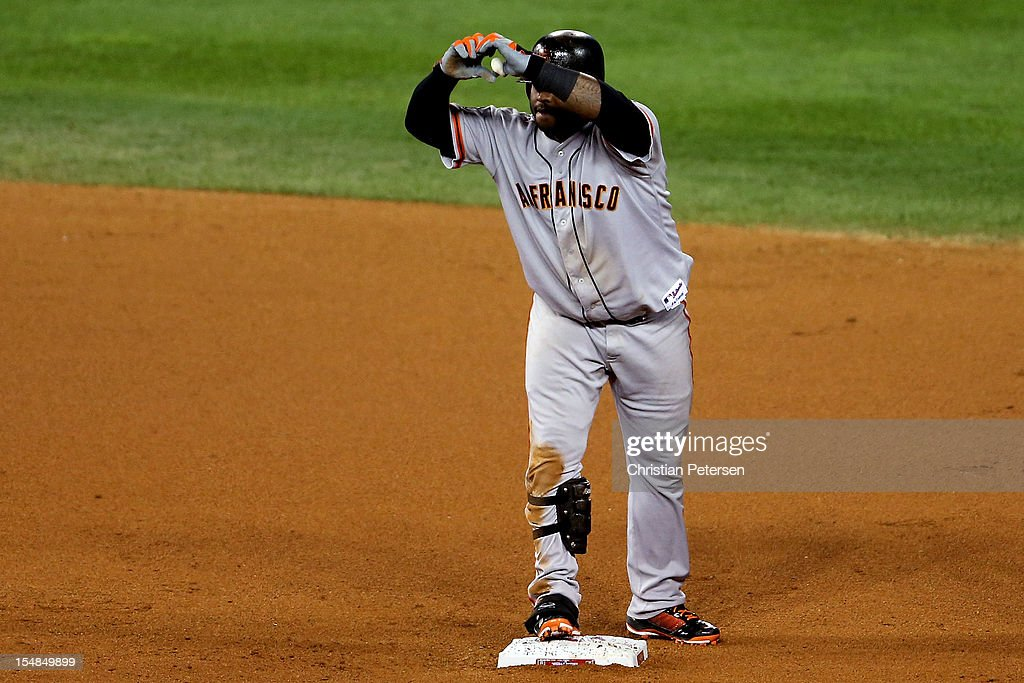 <a gi-track='captionPersonalityLinkClicked' href=/galleries/search?phrase=Pablo+Sandoval&family=editorial&specificpeople=803207 ng-click='$event.stopPropagation()'>Pablo Sandoval</a> #48 of the San Francisco Giants reacts after he hits a double to deep left field against Joaquin Benoit #53 of the Detroit Tigers in the eighth inning during Game Three of the Major League Baseball World Series at Comerica Park on October 27, 2012 in Detroit, Michigan.
