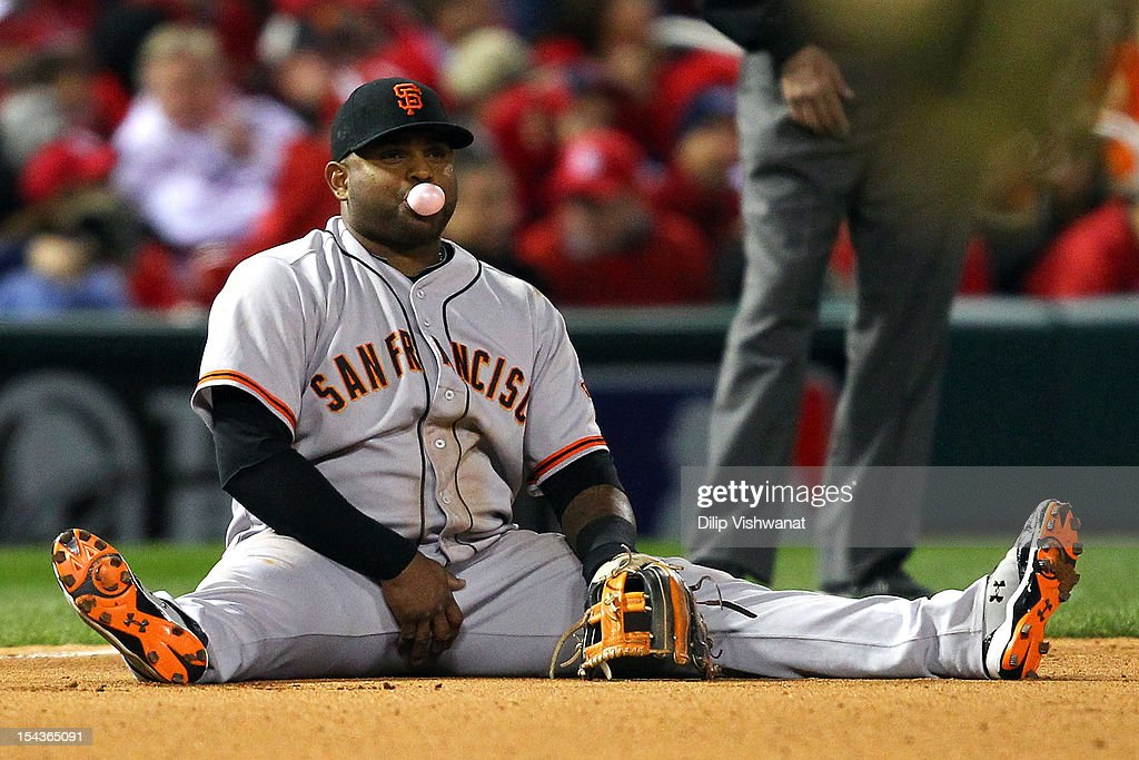 <a gi-track='captionPersonalityLinkClicked' href=/galleries/search?phrase=Pablo+Sandoval&family=editorial&specificpeople=803207 ng-click='$event.stopPropagation()'>Pablo Sandoval</a> #48 of the San Francisco Giants reacts after he is unable to get out Allen Craig #21 of the St. Louis Cardinals on an infield hit in the seventh inning in Game Four of the National League Championship Series at Busch Stadium on October 18, 2012 in St Louis, Missouri.