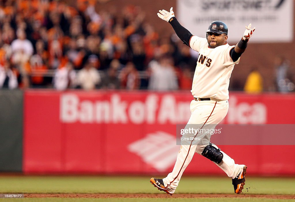 Pablo Sandoval #48 of the San Francisco Giants reacts after hitting a double in the third inning against the St. Louis Cardinals in Game Seven of the National League Championship Series at AT&T Park on October 22, 2012 in San Francisco, California.