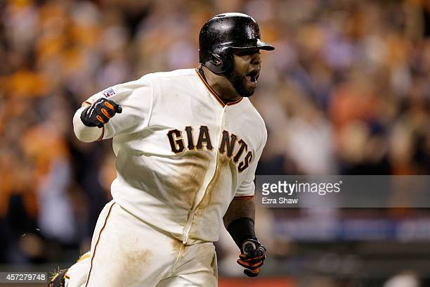 Pablo Sandoval of the San Francisco Giants reacts after hitting a single in the sixth inning against the St Louis Cardinals during Game Four of the...