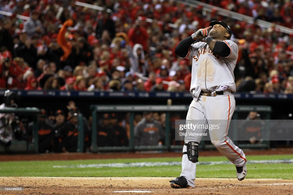 Pablo Sandoval #48 of the San Francisco Giants reacts after hitting a solo home run in the eighth inning against the St. Louis Cardinals in Game Five of the National League Championship Series at Busch Stadium on October 19, 2012 in St Louis, Missouri.