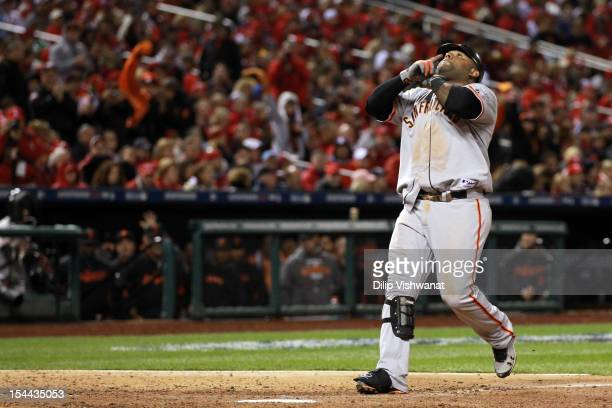 Pablo Sandoval of the San Francisco Giants reacts after hitting a solo home run in the eighth inning against the St Louis Cardinals in Game Five of...