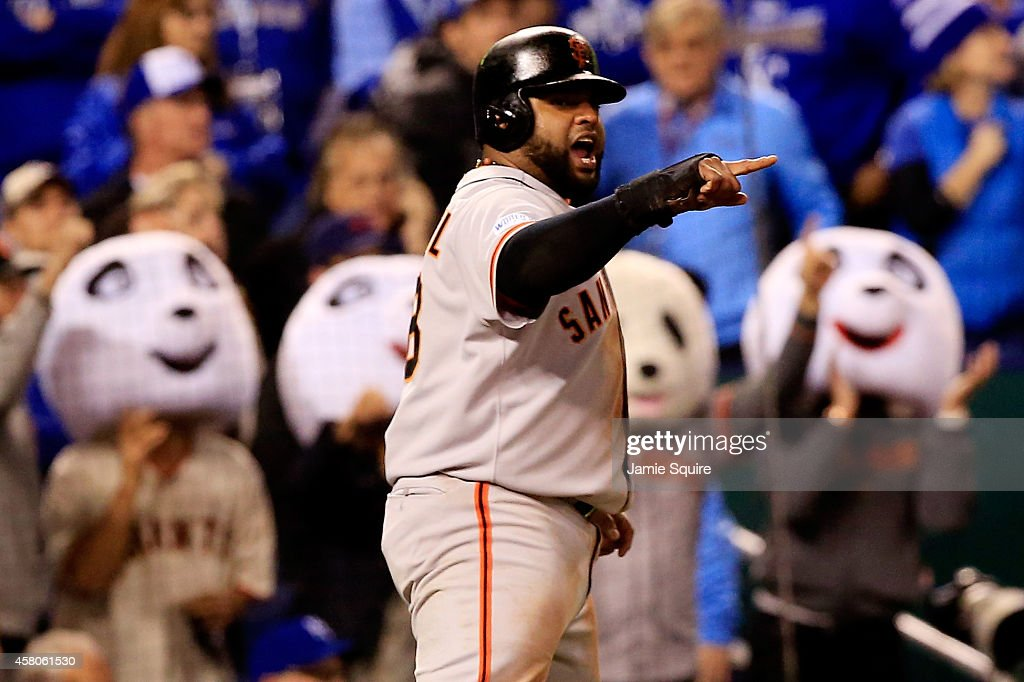 Pablo Sandoval #48 of the San Francisco Giants reacts after scoring in the fourth inning against the Kansas City Royals during Game Seven of the 2014 World Series at Kauffman Stadium on October 29, 2014 in Kansas City, Missouri.