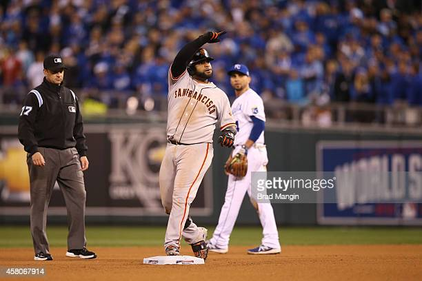 Pablo Sandoval of the San Francisco Giants reacts to hitting a double in the top of the eighth inning of Game 7 of the 2014 World Series against the...