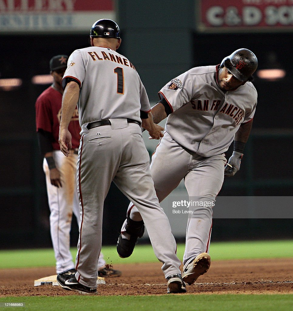 <a gi-track='captionPersonalityLinkClicked' href=/galleries/search?phrase=Pablo+Sandoval&family=editorial&specificpeople=803207 ng-click='$event.stopPropagation()'>Pablo Sandoval</a> #48 of the San Francisco Giants receives congratulations from third base coach <a gi-track='captionPersonalityLinkClicked' href=/galleries/search?phrase=Tim+Flannery&family=editorial&specificpeople=691944 ng-click='$event.stopPropagation()'>Tim Flannery</a> #1 at Minute Maid Park on August 21, 2011 in Houston, Texas.