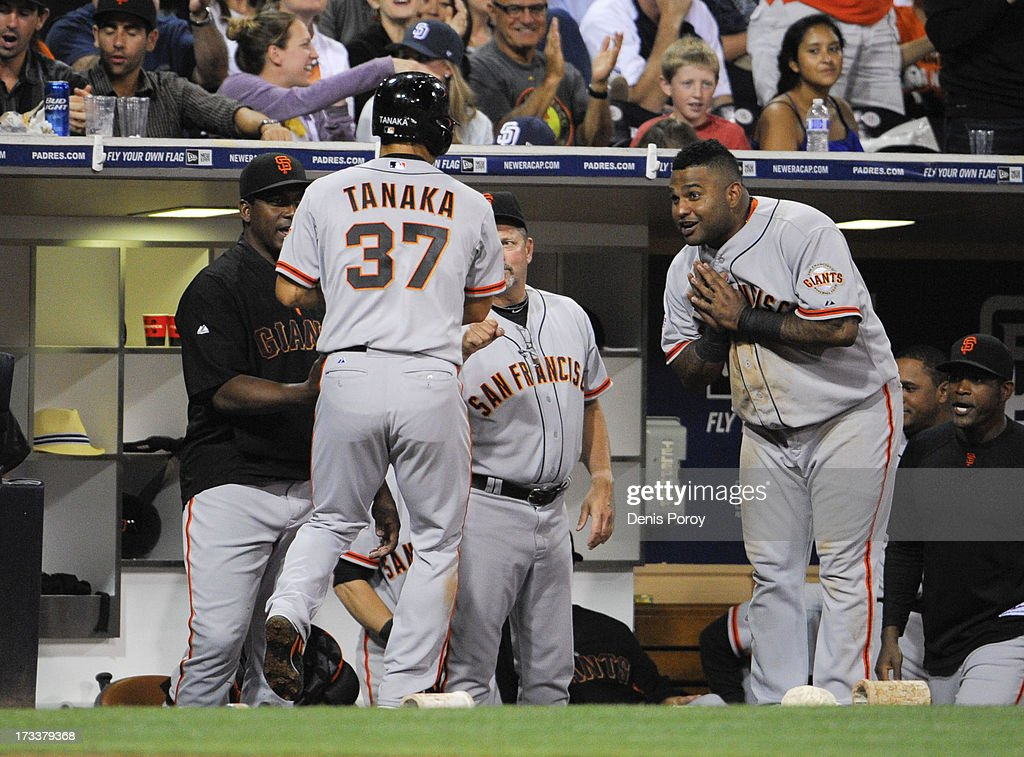 <a gi-track='captionPersonalityLinkClicked' href=/galleries/search?phrase=Pablo+Sandoval&family=editorial&specificpeople=803207 ng-click='$event.stopPropagation()'>Pablo Sandoval</a> #48 of the San Francisco Giants, right, bows to <a gi-track='captionPersonalityLinkClicked' href=/galleries/search?phrase=Kensuke+Tanaka&family=editorial&specificpeople=4014602 ng-click='$event.stopPropagation()'>Kensuke Tanaka</a> #37 after he scored during the seventh inning of a baseball game against the San Diego Padres at Petco Park on July 12, 2013 in San Diego, California.
