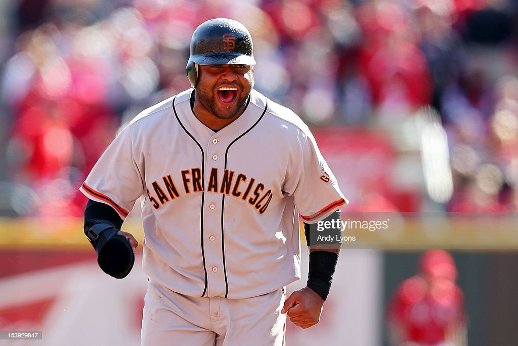 <a gi-track='captionPersonalityLinkClicked' href=/galleries/search?phrase=Pablo+Sandoval&family=editorial&specificpeople=803207 ng-click='$event.stopPropagation()'>Pablo Sandoval</a> #48 of the San Francisco Giants rounds base after a grand slam by Buster Posey #28 in the fifth inning against the Cincinnati Reds during Game Five of the National League Division Series at Great American Ball Park on October 11, 2012 in Cincinnati, Ohio.
