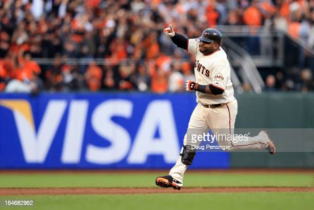 Pablo Sandoval of the San Francisco Giants rounds the bases after hitting a solo home run to center field against Justin Verlander of the Detroit...