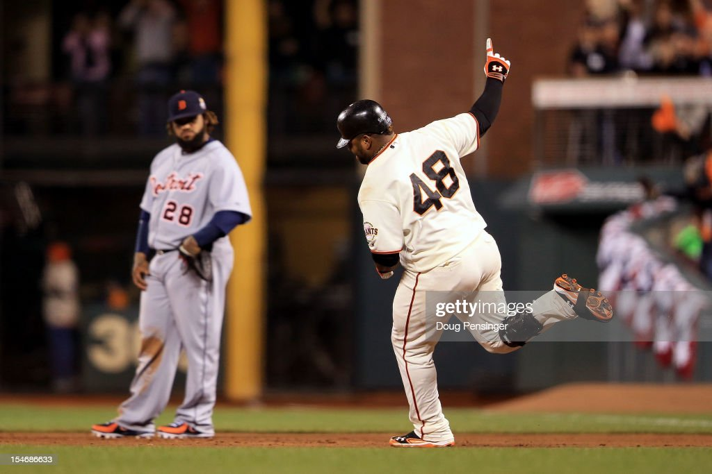 <a gi-track='captionPersonalityLinkClicked' href=/galleries/search?phrase=Pablo+Sandoval&family=editorial&specificpeople=803207 ng-click='$event.stopPropagation()'>Pablo Sandoval</a> #48 of the San Francisco Giants rounds the bases after hitting a solo home run to center field against Al Alburquerque #62 of the Detroit Tigers in the fifth inning during Game One of the Major League Baseball World Series at AT&T Park on October 24, 2012 in San Francisco, California.