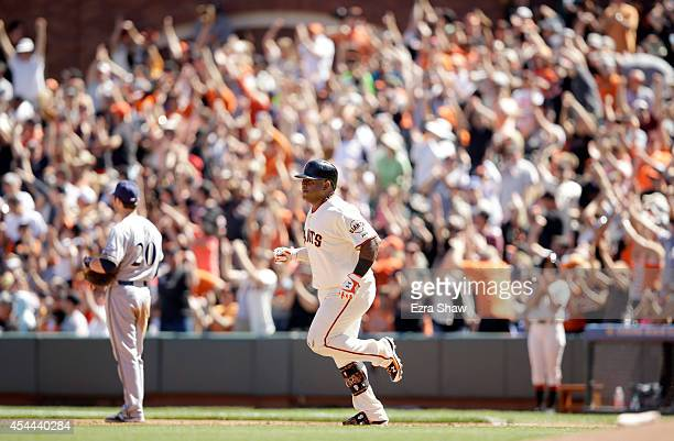 Pablo Sandoval of the San Francisco Giants rounds the bases after he hit a tworun home run in the fifth inning of their game against the Milwaukee...