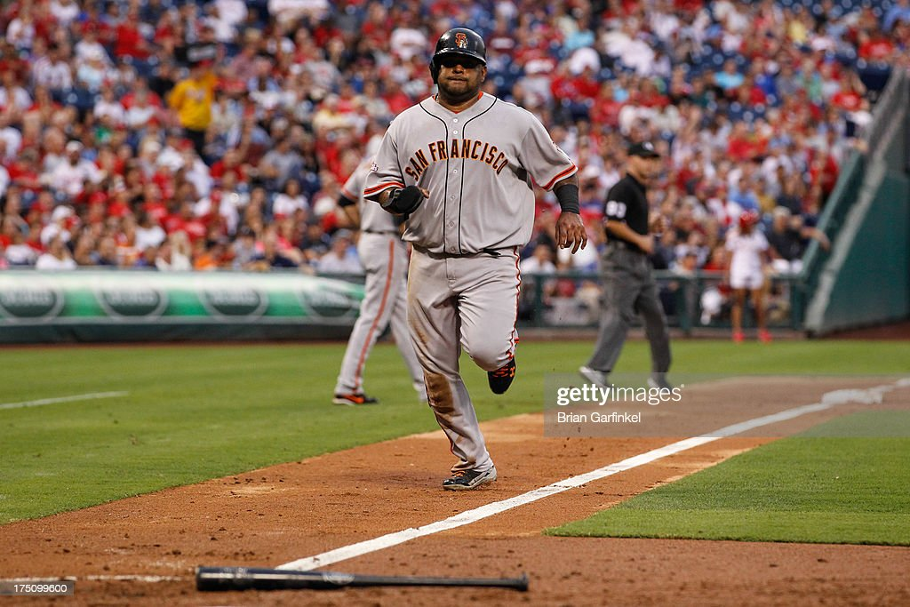 <a gi-track='captionPersonalityLinkClicked' href=/galleries/search?phrase=Pablo+Sandoval&family=editorial&specificpeople=803207 ng-click='$event.stopPropagation()'>Pablo Sandoval</a> #48 of the San Francisco Giants scores a run in the third inning of the game against the Philadelphia Phillies at Citizens Bank Park on July 31, 2013 in Philadelphia, Pennsylvania.