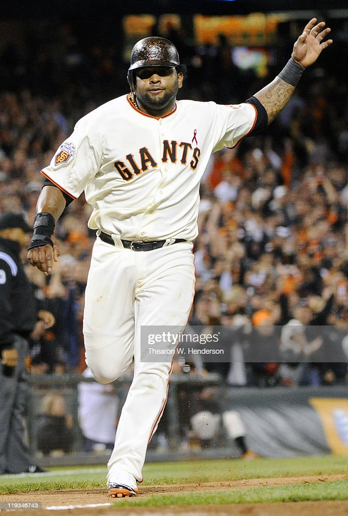 <a gi-track='captionPersonalityLinkClicked' href=/galleries/search?phrase=Pablo+Sandoval&family=editorial&specificpeople=803207 ng-click='$event.stopPropagation()'>Pablo Sandoval</a> #48 of the San Francisco Giants scores and waves home Nate Schierholtz on a two-RBI double by Cody Ross against the Los Angeles Dodgers in the sixth inning during an MLB baseball game at AT&T Park July 18, 2011 in San Francisco, California.