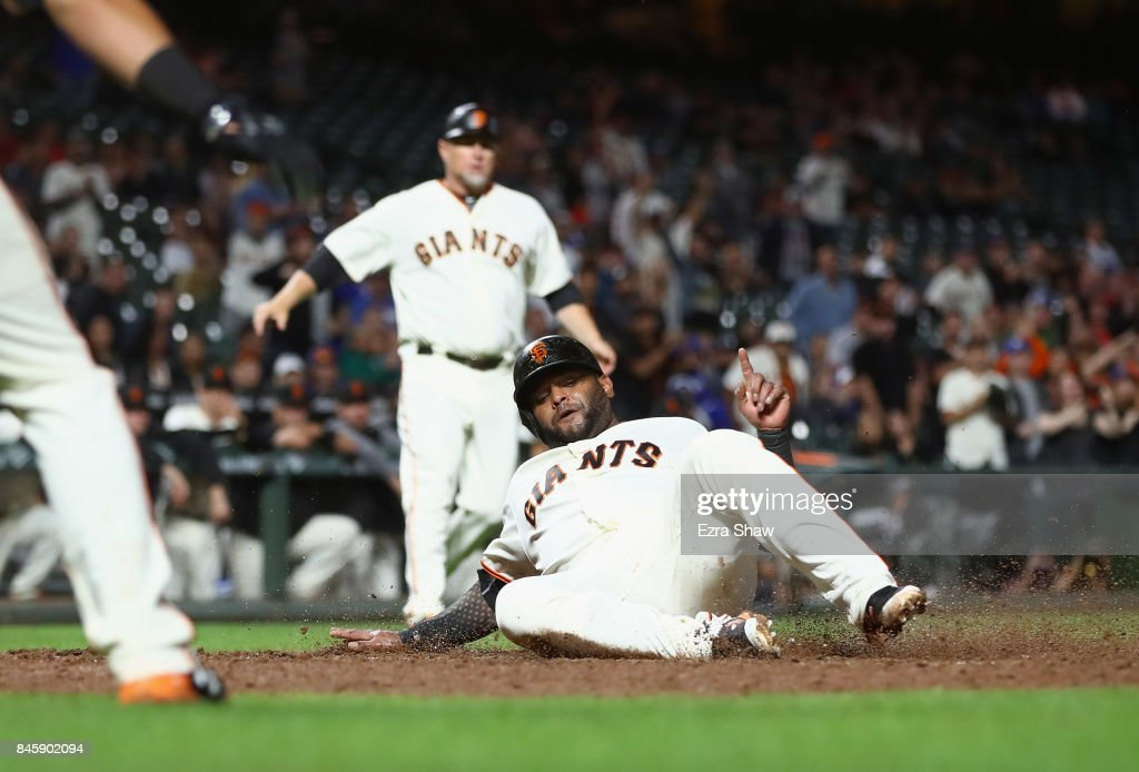 Pablo Sandoval #48 of the San Francisco Giants scores on a hit by Hunter Pence #8 in the sixth inning against the Los Angeles Dodgers at AT&T Park on September 11, 2017 in San Francisco, California.